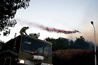 Israel : Israeli firefighters work on the slope of a burning hill on the edge of Tirat Ha Carmel near the northern city of Haifa on December 3, 2010. Around 40 people are believed to have been killed in the devastating forest fire burning.© ALESSIO ROMENZI