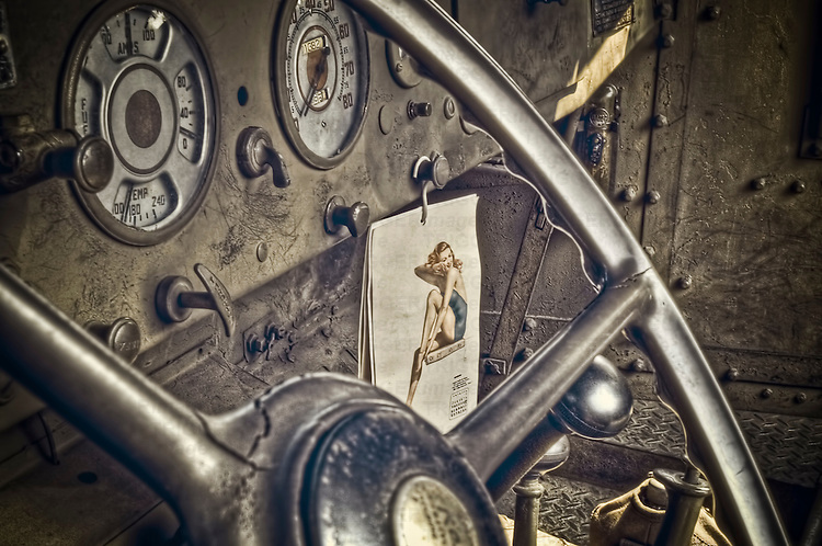 World War II truck interior shows a GI's pin up girl calendar.