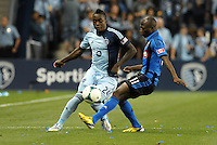 KANSAS CITY, KS - June 1, 2013:<br /> Mechack Jerome (24) defender Sporting KC , Sanna  Nyassi (11) midfield Montreal Impact .<br /> Montreal Impact defeated Sporting Kansas City 2-1 at Sporting Park.
