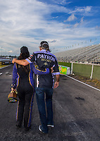 Sept. 1, 2014; Clermont, IN, USA; NHRA  funny car driver Alexis DeJoria (left) walks with her father John Paul DeJoria as they celebrate after winning the US Nationals at Lucas Oil Raceway. Mandatory Credit: Mark J. Rebilas-USA TODAY Sports