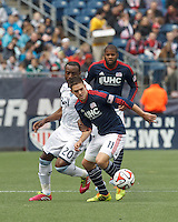 New England Revolution midfielder Kelyn Rowe (11) at midfield.  In a Major League Soccer (MLS) match, the New England Revolution (blue/white) tied Vancouver Whitecaps FC (white), 0-0, at Gillette Stadium on March 22, 2014.