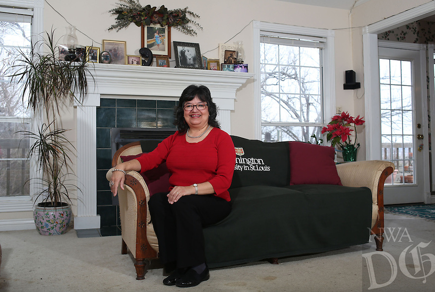 NWA Democrat-Gazette/DAVID GOTTSCHALK  Diane Worthen sits in her favorite personal space Tuesday, February 28, 2017, her living room with family portraits, pictures and window views in Springdale.