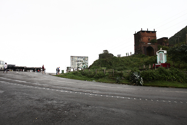 A brick tower and concrete bunkers from the French colonial era draw tourists daily at the Hai Van Pass north of Da Nang, Vietnam. Dec. 27, 2012.