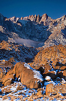 711700278 winter sunrise with snow covered granite boulders in the bureau of land management protected land the alabama hills in the southern section of the eastern sierras with mount whitney in the background in kern county california