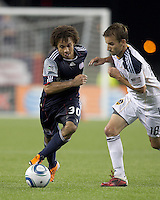 New England Revolution defender Kevin Alston (30) on the attack as Los Angeles Galaxy midfielder Mike Magee (18) defends. In a Major League Soccer (MLS) match, the Los Angeles Galaxy defeated the New England Revolution, 1-0, at Gillette Stadium on May 28, 2011.