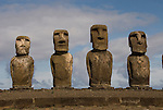 Chile, Easter Island: Array of statues or moai on a platform or ahu at Ahu Tongariki, near the quarry Rano Raruku.  This is the largest array of moia on Easter Island, consisting of 15 moai..Photo #: ch238-32726.Photo copyright Lee Foster www.fostertravel.com lee@fostertravel.com 510-549-2202