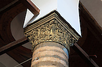 Detail of a carved capital atop a circular striped pillar in the nave of the Church of St Spiridon, 18th - 19th centuries, completed 1864, in the Gorica quarter of Berat, South-Central Albania, capital of the District of Berat and the County of Berat. The church is a 3-nave basilica with two lower side naves and a bell tower. Picture by Manuel Cohen