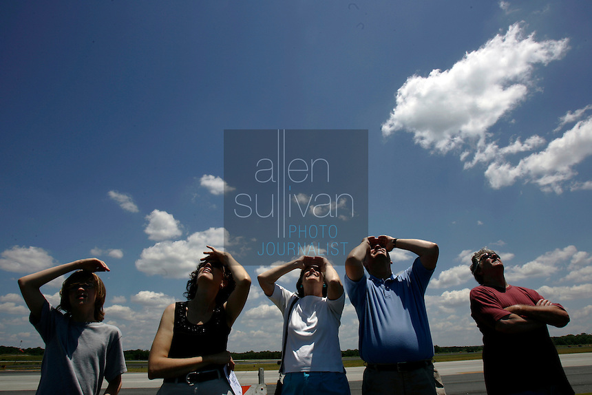 People watch Team RV planes perform during the Good Neighbor Day Air Show at Dekalb Peachtree Airport in Atlanta on Saturday, June 3, 2006.