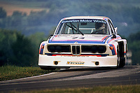 Sam Posey lifts both inside wheels of his BMW 3.0 CSL entering the Keyhole turn during the IMSA Camel GT race at the Mid-Ohio Sports Car Course near Lexington, Ohio, on June 1, 1975. (Photo by Bob Harmeyer)