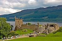 Tourists visit Urquhart Castle on Lock Ness