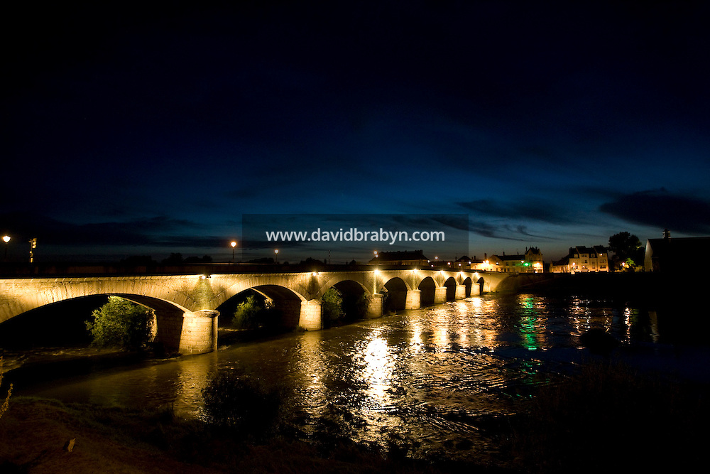 Nighttime view of a bridge over the Loire river in Amboise, France, 26 June 2008.