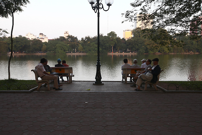 People enjoy a quiet moment alongside the Lake of the Restored Sword in the Old Quarter of Hanoi, Vietnam. Nov. 12, 2012.