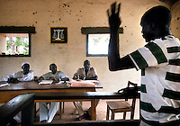 Judges listen to the testimonies of a legal case in a local court of law. The de facto state of 'New Sudan' has set up its own legal system.