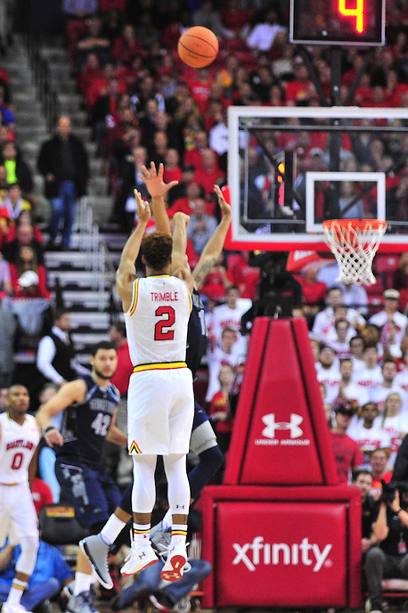 Melo Trimble of the Terrapins drains a 3-point shot. Maryland defeated Georgetown 75-71 during a game at Xfinity Center in College Park, MD on Wednesday, November 17, 2015.  Alan P. Santos/DC Sports Box