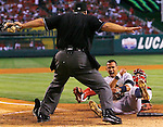 The Yankees' Alex Rodriguez celebrates as he slides safely into home after taging up on a pop-fly in the 4th inning during game four of the American League Championship Series between the Los Angeles Angels of Anaheim and the New York Yankees at Angels Stadium on Monday, October 20, 2009. At right is Angels' catcher Mike Napoli.