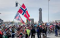 peloton passing the 'Ijzertoren' war memorial in Diksmuide<br /> <br /> 79th Gent-Wevelgem 2017 (1.UWT)<br /> 1day race: Deinze &rsaquo; Wevelgem - BEL (249km)