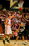 13 February 2011: University of Vermont Catamount forward Brian Voelkel, a Freshman from Pleasantville, NY, in action against the Binghamton University Bearcats at Patrick Gymnasium in Burlington, Vermont. The Catamounts came from behind to defeat the Bearcats 60-51 in their America East matchup. The Cats took part in the National Pink Zone Breast Cancer Awareness Program by wearing special white jerseys with pink trim. The jerseys were auctioned off following the game with proceeds going to the Vermont Cancer Center. Mandatory Credit: Ed Wolfstein Photo