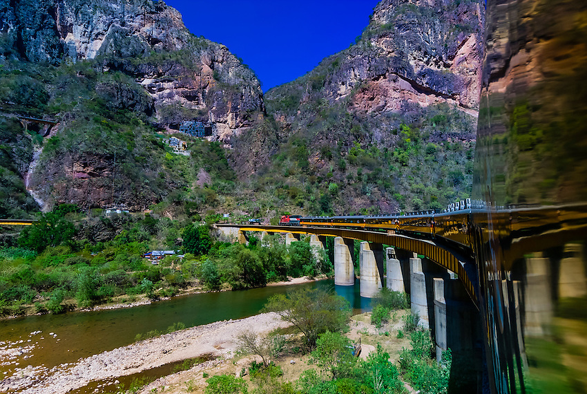 The CHEPE (Chihuahua al Pacifico Railroad) train passes over the Santa Barbara Bridge, near Temoris, Copper Canyon, Mexico