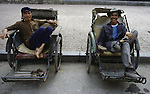 Pedicab drivers wait for customers in Hanoi, North Vietnam.  (Jim Bryant Photo).....