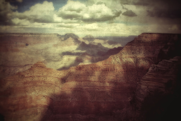 Huge canyon looking across the Grand Canyon in USA in a blue summer sky with texture layer