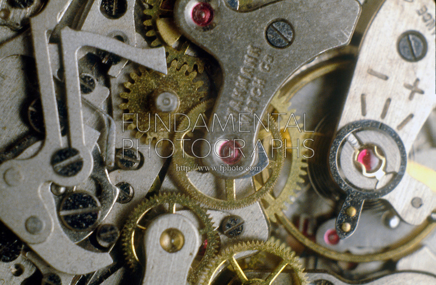MECHANICAL WATCH MECHANISM<br /> Closeup Of Gear Train And Escapement Wheel<br /> Gears can transfer motion from one place to another. They are used to reverse the direction of rotation, increase or decrease the speed of rotation, move rotational motion to a different axis, or keep the rotation of two axes synchronized.