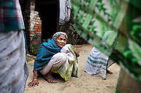 """Saraswati Saha, 84, a refugee of The Partition discusses her situation with other elderly women in Cooper's Camp, Nadia district, Ranaghat, North 24 Parganas, West Bengal, India, on 19th January, 2012. She vividly remembers being brought to the refugee camp first by train and then truck. """"My daughter has died and I'm still here,"""" she says over and over again. Over 60 years after the bloody creation of Bangladesh in 1947, refugees who fled what was then known as West Pakistan to India still live as refugees, standing in line for government handouts..Photo by Suzanne Lee for The National (online byline: Photo by Szu for The National)"""