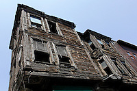 Low angle view of old wooden traditional houses, Istanbul, Turkey. Ottoman Istanbul was a predominantly wooden city but in the 20th century many of the old houses were replaced by more solid structures. Efforts are now being made to preserve the traditional wooden architecture. Picture by Manuel Cohen.