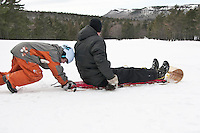 Sledding at the Keweenaw Mountain Lodge in Copper Harbor Michigan in winter.