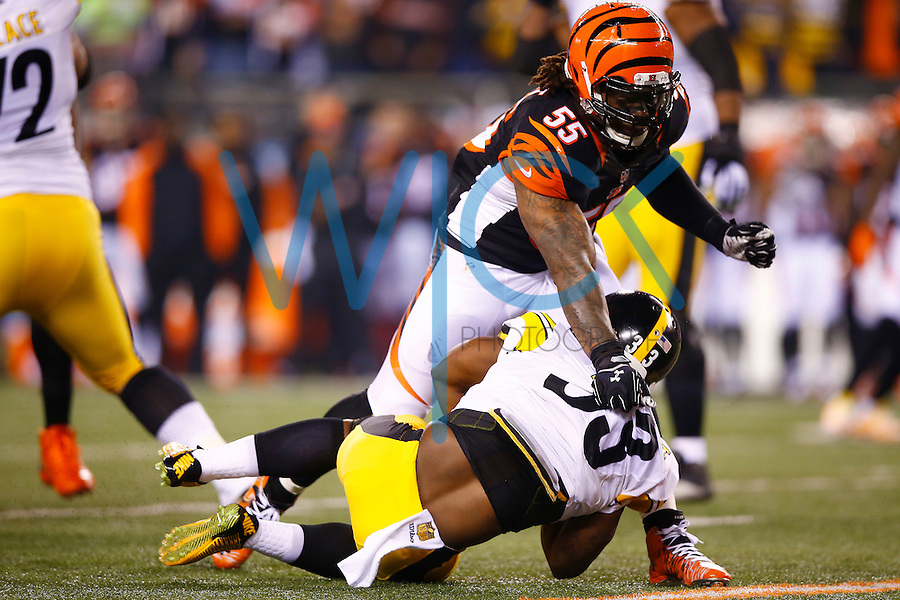 Vontaze Burfict #55 of the Cincinnati Bengals tackles Fitzgerald Toussaint #33 of the Pittsburgh Steelers for a loss on the first drive during the Wild Card playoff game at Paul Brown Stadium on January 9, 2016 in Cincinnati, Ohio. (Photo by Jared Wickerham/DKPittsburghSports)