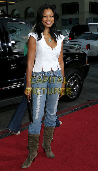 "GARCELLE BEAUVAIS-NILON.The Los Angeles premiere of ""The Dukes Of Hazzard"".Graumans Chinese Theatre,.Hollywood, 28th July 2005.full length white shirt top denim jeans brown clutch bag boots turquoise nacklace pendant.www.capitalpictures.com.sales@capitalpictures.com.© Capital Pictures."