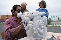 Inuvik, NWT, Northwest Territories, Arctic Canada - Inuit (Eskimo) Artist carving Soapstone Sculpture