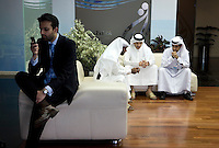Men sit and talk in the foyer of news channel Al Jazeera in Doha.