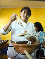 Mexico (04.04.2006)  A Mexican cook prepares tostadas of salpicon ( a fried tortilla seasoned with ripped meat, avocado, onion and chile)  in her stand in a Mexico City's restaurant, April 04, 2006.  Photo by © Javier Rodriguez