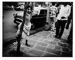 Young girl on a Colaba street, Mumbai, India.