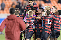 Houston, TX -  Friday, December 9, 2016: The Stanford Cardinal celebrate after defeating the North Carolina Tar Heels in an overtime shootout  at the  NCAA Men's Soccer Semifinals at BBVA Compass Stadium.