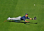 24 September 2012: Milwaukee Brewers outfielder Carlos Gomez dives to make an outfield catch but comes up short due to the strong sun during a game against the Washington Nationals at Nationals Park in Washington, DC. The Brewers fell 12-2 to the Nationals in the final game of their 4-game series, splitting the series at two. Mandatory Credit: Ed Wolfstein Photo