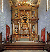 Altarpiece in the chancel of Sao Miguel Chapel, or St Michael's Chapel, designed in Manueline style 1517-22 by Marco Pires and completed by Diogo de Castilho, on the site of a 12th century chapel in the University of Coimbra, Coimbra, Portugal. The Mannerist altarpiece was designed by Bernardo Coelho in 1605 and made by sculptor Simon Mota, with paintings by Simon Rodrigues and Domingos Vieira Serrao. The chapel was renovated in the 17th and 18th centuries, with Manuel Ramos making the pulpit in 1684, ceiling painted by Francisco F de Araujo, tiled floor added 1613, Baroque organ with 2,000 pipes built 1733 by Fray Manuel de Sao Bento, and Gabriel Ferreira da Cunha painting chinoiserie elements in 1737. The University of Coimbra was first founded in 1290 and moved to Coimbra in 1308 and to the royal palace in 1537. The building is listed as a historic monument and a UNESCO World Heritage Site. Picture by Manuel Cohen