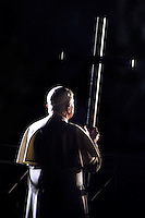 Pope Benedict XVI holds the wooden cross during the Via Crucis (Way of the Cross) torchlight procession on Good Friday in front of the Colosseum in Rome, Friday, April 10, 2007.The evening Via Crucis procession at the ancient Colosseum amphitheater is a Rome tradition that draws a large crowd of faithful, including many of the pilgrims who flock to the Italian capital for Holy Week ceremonies before Easter SundayVia Crucis;