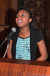 January 11, 2012 - Brooklyn, New York, USA: Sheimyrah Mighty, 13-year-old Jamaican Haitian-American, sings National Anthem at 2nd Annual Interfaith Memorial Service for Haiti, Wednesday night at Brooklyn Borough Hall. The service was held two years after the Mw 7.0 earthquake at Haiti..Among those participating in the Second Annual Interfaith Memorial Service for Haiti were music and literary artists; Christian, Muslim, Jewish spiritual and community leaders; Haitian officials; relief workers; and politicians.