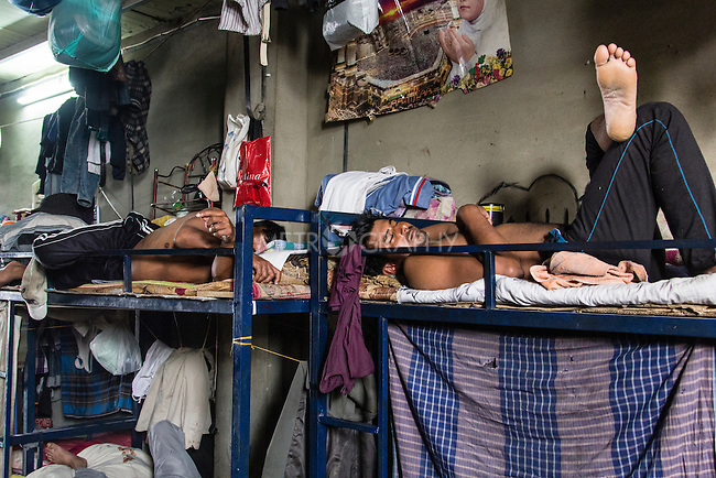 10/10/2014 -- Kirkuk, Iraq -- Two Bangladeshi workers are sleep in their bedroom in the afternoon during the two hours break they have.