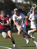 Boston College midfielder Caroline Margolis (21) on the attack as Harvard University defender/midfielder Lauren Tomkinson (3) defends.