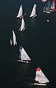 Extreme Sailing Series 2011. Leg 1. Muscat. Oman.Day 5 of racing.   Picture showing Luna Rossa leading the fleet.