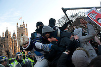 Protestors outside the Houses of Parliament during a student demonstration in Westminster, central London on the day the government passed a bill to increase university tuition fees. .