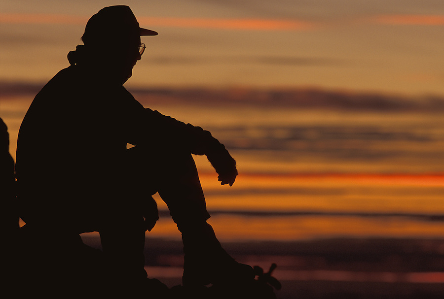 Man silhouetted against sunset