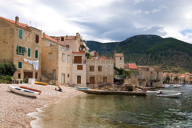 Old houes near the pier at Komiza, on the island of Vis, Croatia. ..