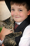 young cowboy holding a kitten
