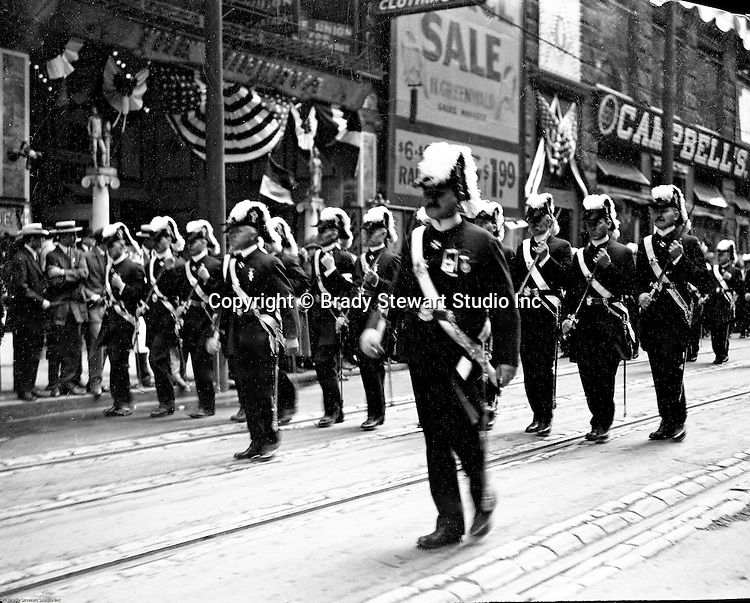Pittsburgh PA:  Pittsburgh-area Manson marching in the annual St Patrick's Day Parade - 1903.  View of Officer and troop marching down 5th Avenue with crowds lining both sides of the street.