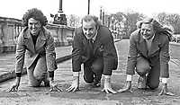 Ready, steady, go! Three new members of the N Ireland Sports Council get on their marks at the front of Parliament Buildings, Stormont, Belfast. L to R - Maeve Kyle, twice an Olympics participant and sports administrator, Ivan Cooper, SDLP assemblyman, and Olympic gold medallist Mary Peters. 197403080148.<br />