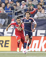 New England Revolution defender Kevin Alston (30) brings the ball forward as Chicago Fire forward Sherjill MacDonald (7) closes. In a Major League Soccer (MLS) match, the New England Revolution (blue) defeated Chicago Fire (red), 1-0, at Gillette Stadium on October 20, 2012.