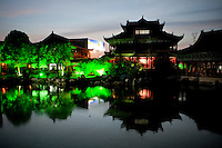 An artificial lake at The West Lake Restaurant in Changsa. Able to seat up to 5,000 people at one sitting, The West Lake Restaurant is the biggest Chinese restaurant in the world. Each week its diners, who staff are taught are 'the bringers of good fortune', devour 700 chickens, 200 snakes, 1,200 kgs of pork and 1,000 kgs of chillis. Its 300 chefs cook in five kitchens and its staff total more than 1,000.It is fully booked most nights.